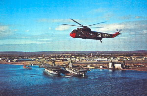 A Vintage Post Card View Of A Helicopter Over Quonset Point Naval Air Station