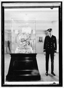 Navy Lieutenant Adolphus W. Gorton standing next to the Curtis Marine Flying Trophy which he won in 1922. Library Of Congress Photo
