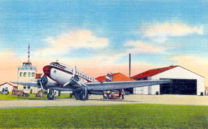 Postcard view showing a Northeast Airlines plane.