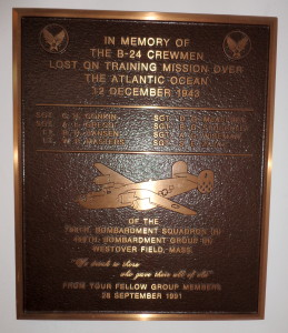 A bronze memorial plaque at the New England Air Museum honoring the lost crew of a B-24 Liberator (42-7225)